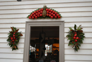 they are all part of the grand colonial williamsburg tradition of decorating the doors in the historic area with wreaths