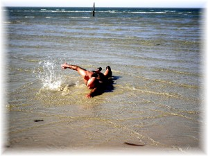 Victor Abrahamian takes a shallow swim in the Chesapeake Bay at Cape Charles for Habitat for Humanity charity event